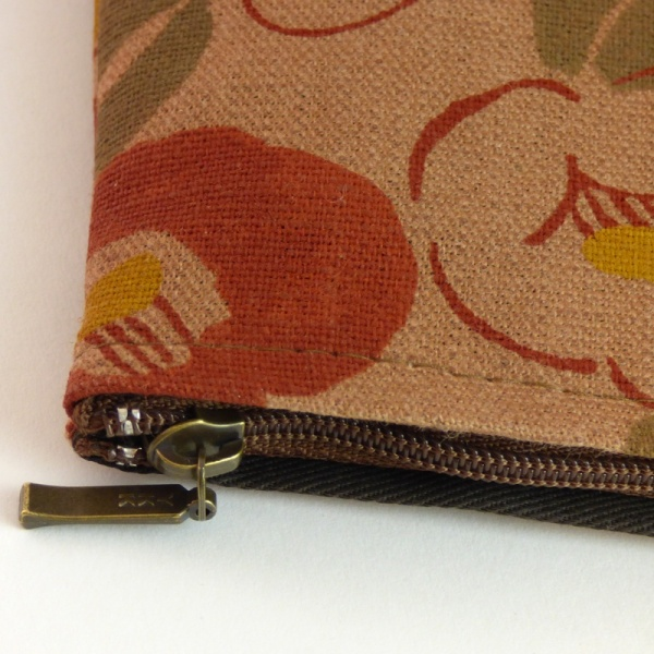 Close up of canvas zip bag with Camellia design