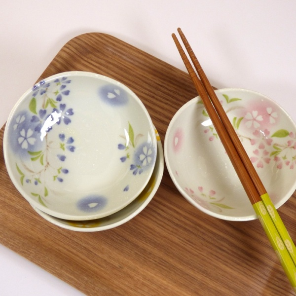 Three 'Petal' bowls on a tray with chopsticks