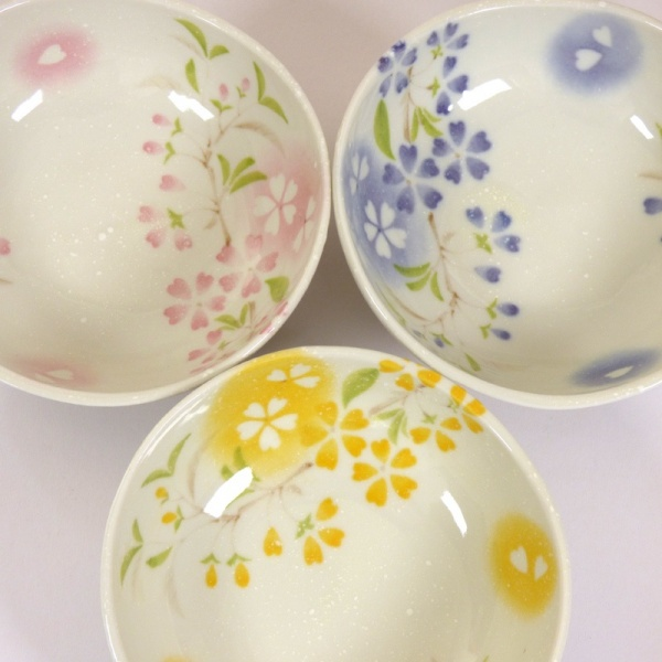 Three 'Petal' bowls in pink, blue and yellow