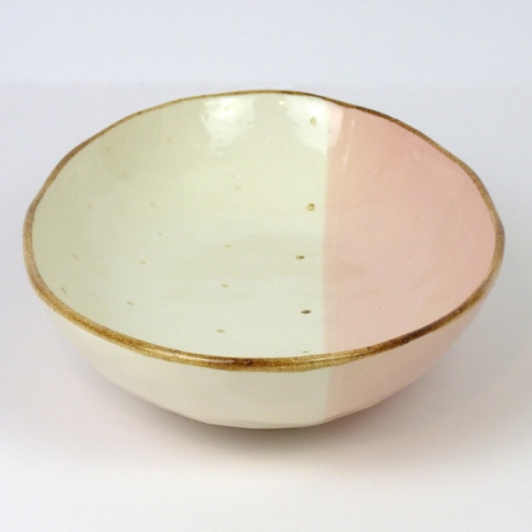 Pink and white oval curry plate showing dip glaze design