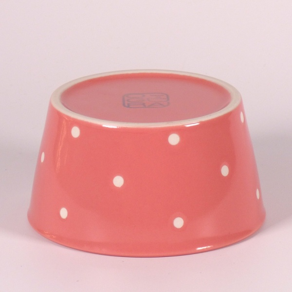 Underside of Small pink ceramic food storage and microwave dish