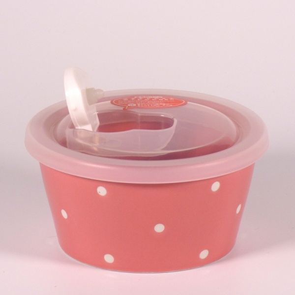 Small pink ceramic food storage and microwave dish