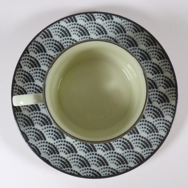 Monochrome Qinghai wave pattern coffee cup with saucer, top down view