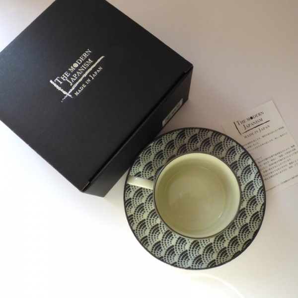 Coffee cup and saucer with black gift box
