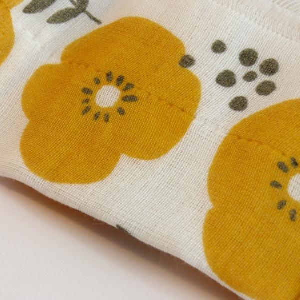Reusable fabric kitchen cloth with yellow flowers close up
