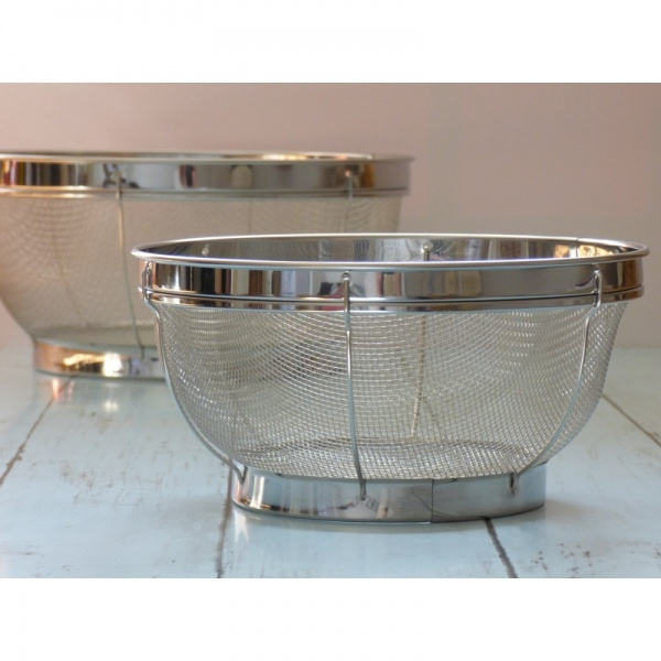 Smaller of the two kitchen sieves standing on work surface