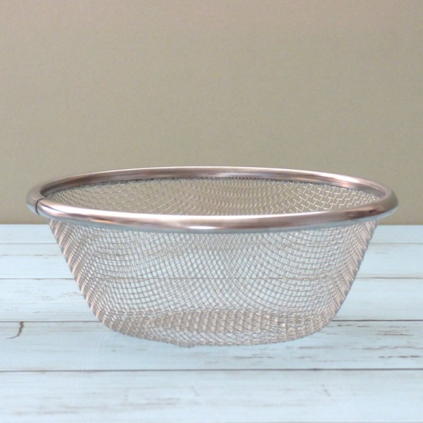 Smaller stainless steel sieve on kitchen work top