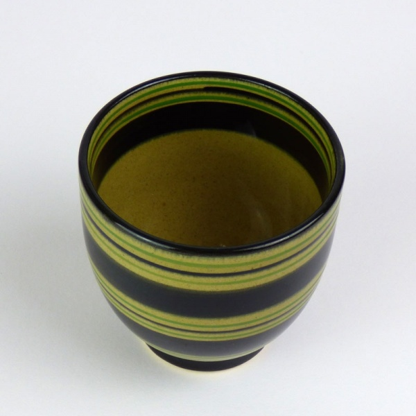 Black Japanese tea cup with green stripe pattern top view