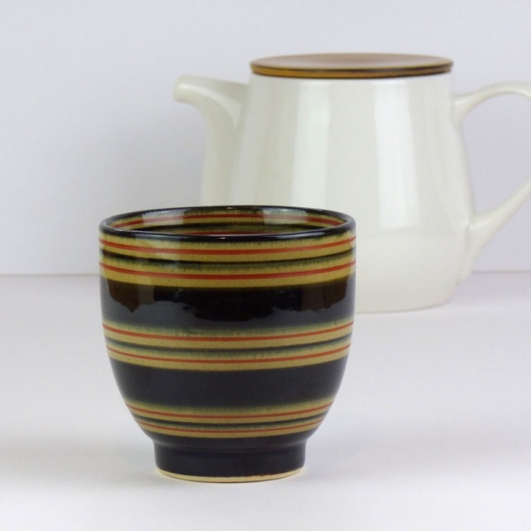 Black Japanese tea cup with Japanese teapot