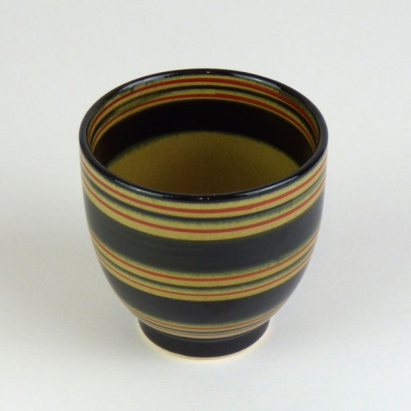 Black Japanese tea cup with red stripe pattern