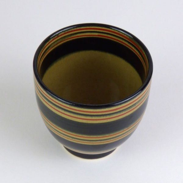 Black Japanese tea cup with red stripe pattern top view