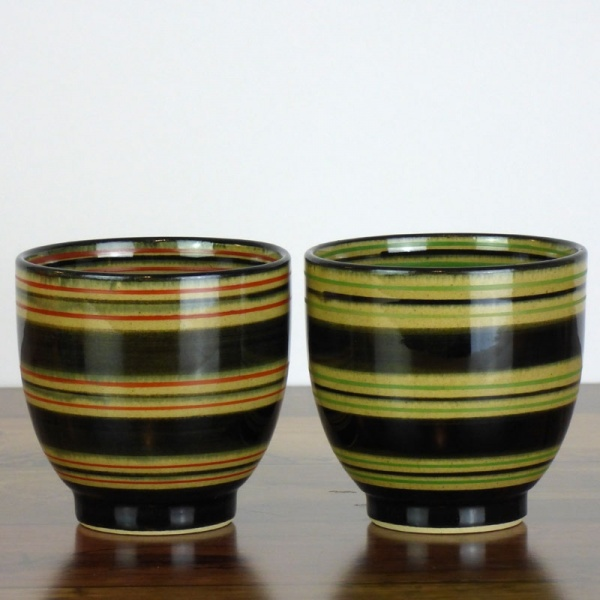 Pair of Japanese tea cups with green and red stripe patterns