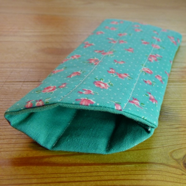 Handmade quilted glasses case in turquoise rose print