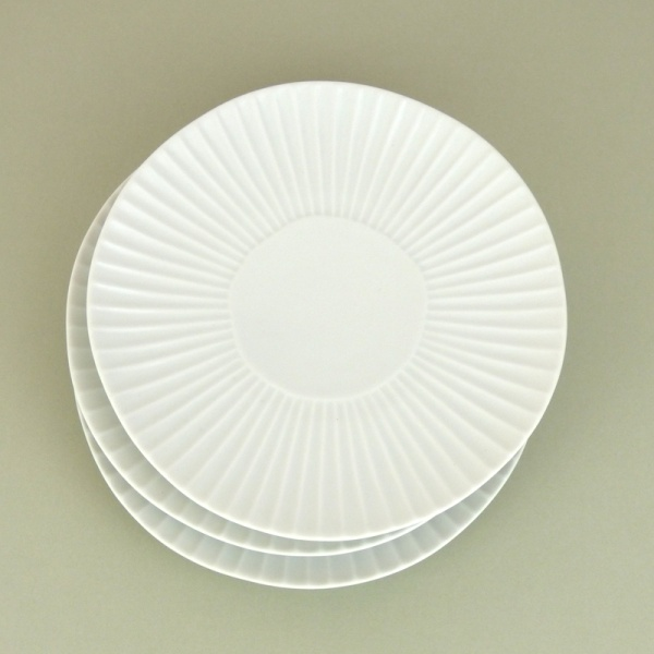 Matte white daisy design Japanese plates in a stack