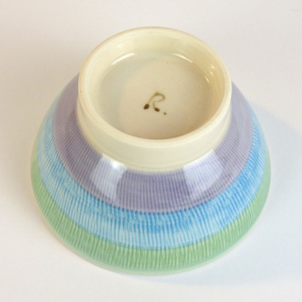 Japanese ceramic bowl with green, blue and purple striped pattern