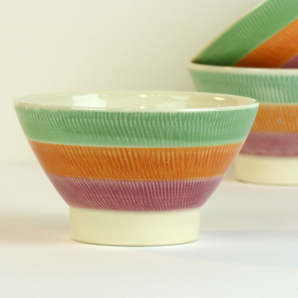 Hasami ware Japanese ceramic bowl with green, orange and red striped pattern