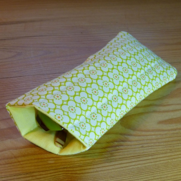 Handmade quilted glasses case in a yellow geometric print