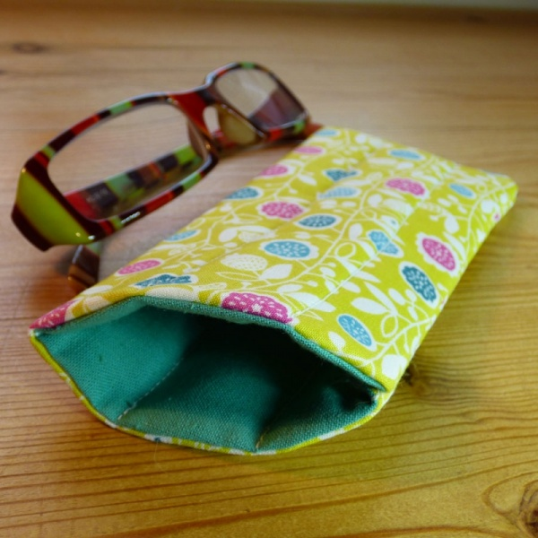 Handmade quilted glasses case in yellow vine floral print - shown with glasses